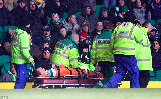 Old Fashioned Football Putting Players on Stretchers